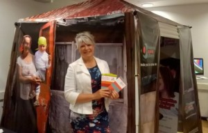 Jane Wright at the Business Against Poverty amazing marketing hut designed and donated by DigiPrint, Trowbridge