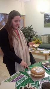 Catherine Brookes, Wiltshire Council cutting the official coffee morning cake!