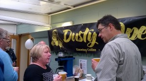 Val Huxley and Evan Metz  discussing coffee and CSR